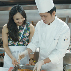 Ching in the kitchen during the filming of Ching's Amazing Asia