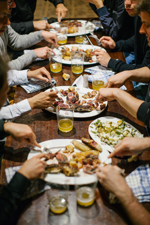 diners tuck into Basque food at