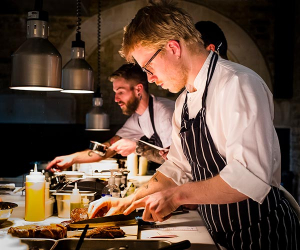 Tom Adam's presenting plates in the kitchen of Coombeshead farm