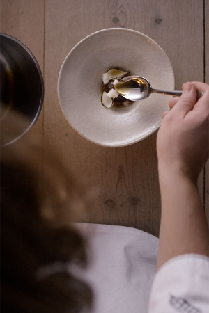 Chef Magnus Nilsson prepares a dish in an episode of Chef's Table
