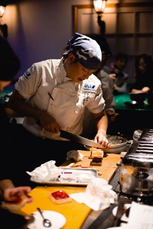 Kentaro Nakahara cooking at ANA's Culinary Journeys event