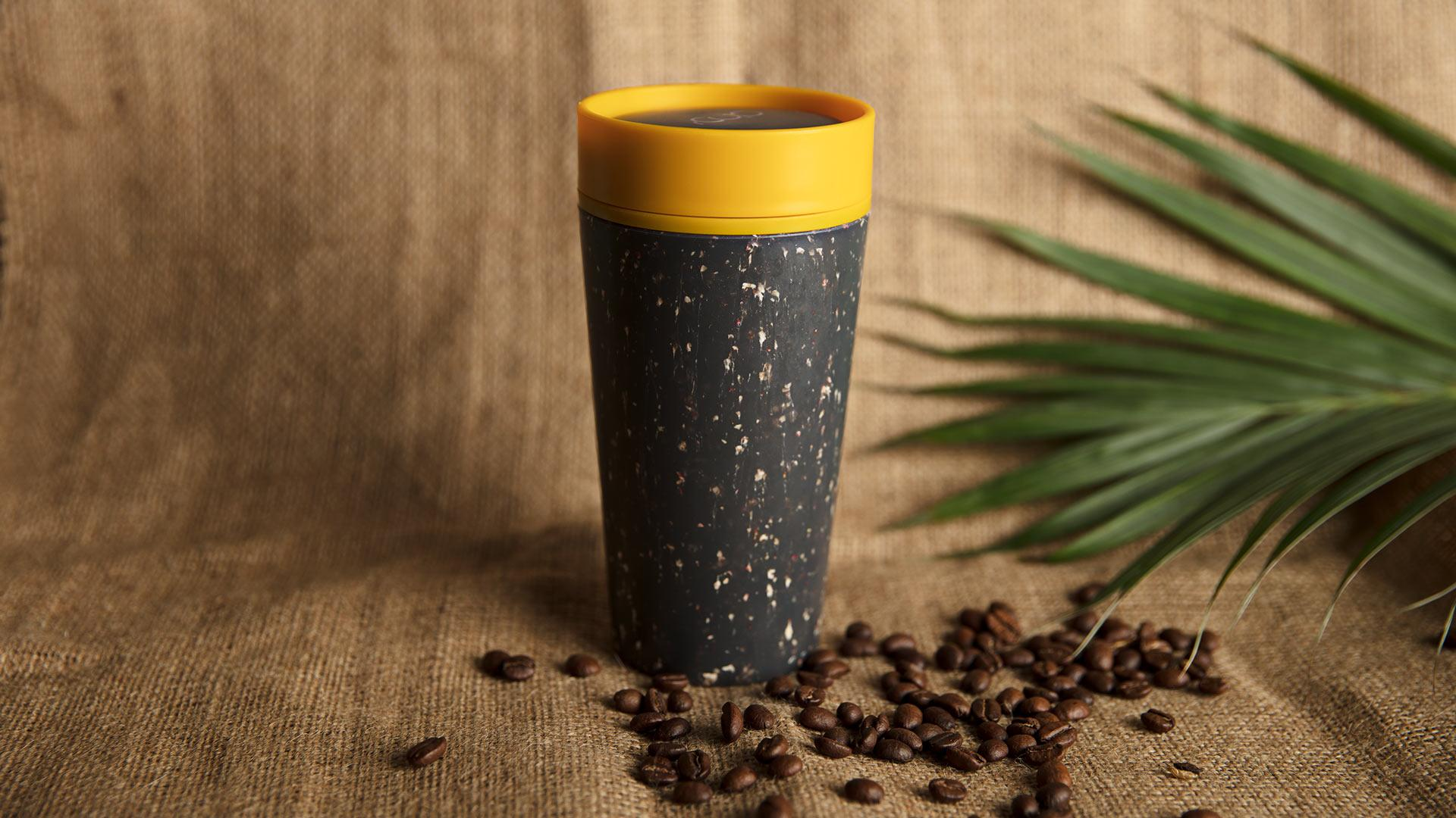 rCUP's reusable coffee cup in mustard and black