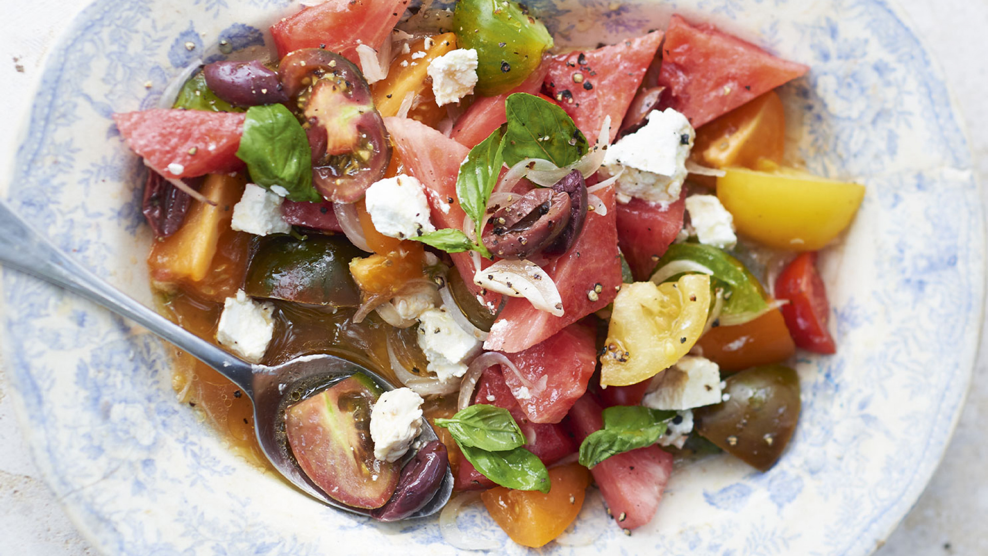 Watermelon and tomato salad with goat's cheese.  Photograph by David Munns