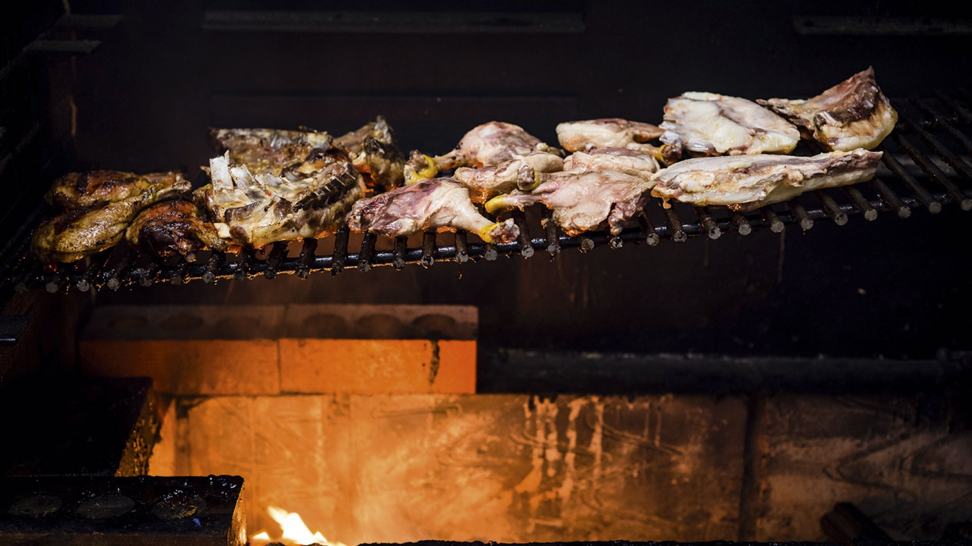Goat on the grill at Smoking Goat