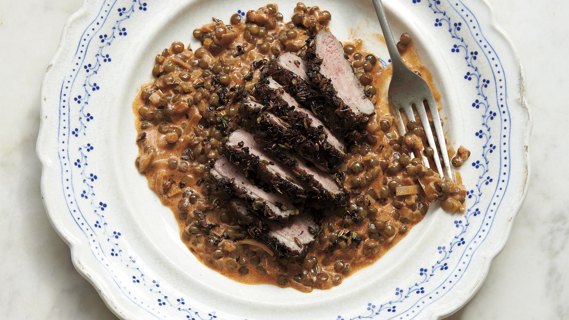 Emma Spitzer's seared duck with spiced lentils. Photography by Claire Winfield