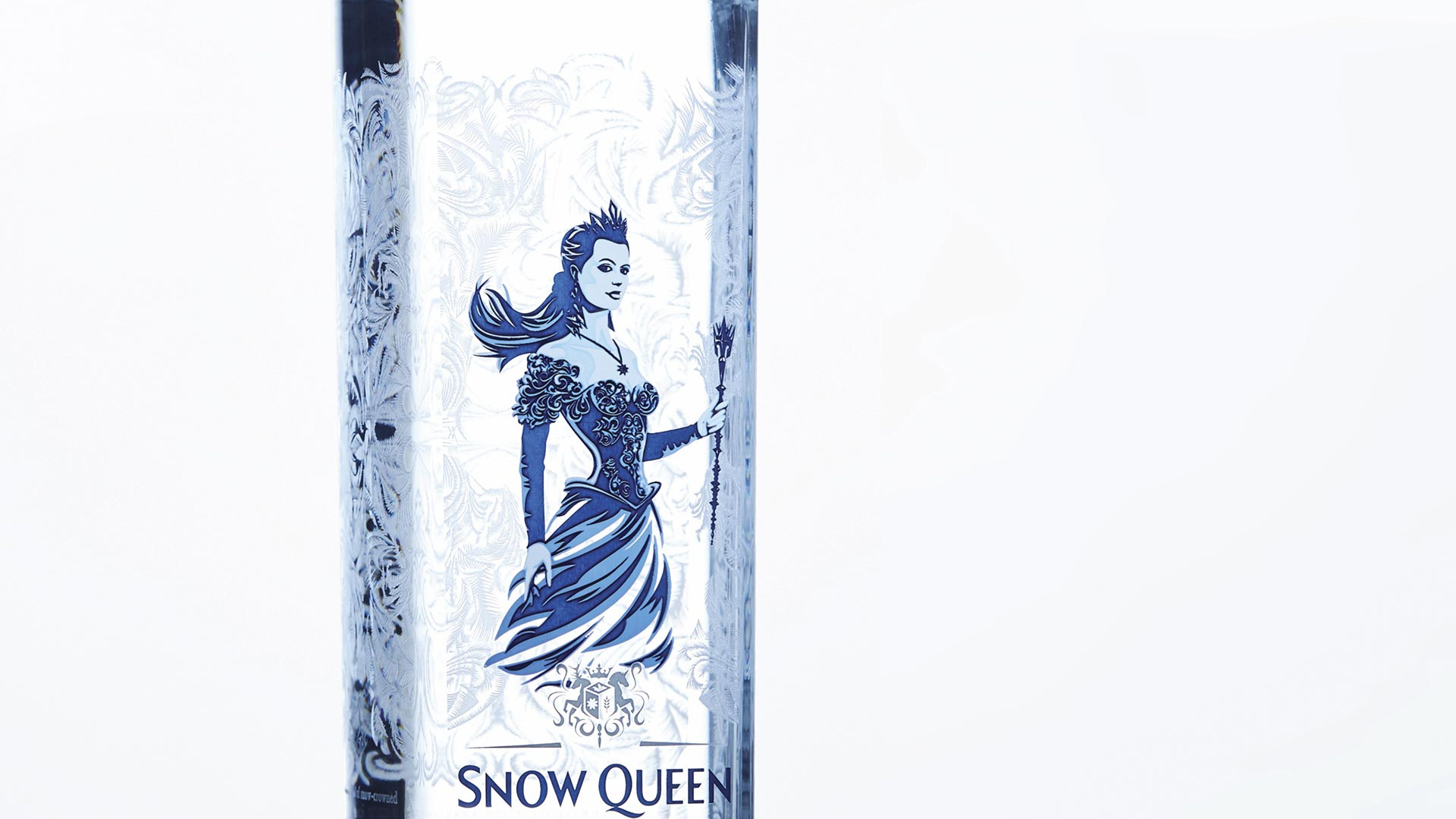 Bottle of Snow Queen vodka with its wintery blue logo on a white background