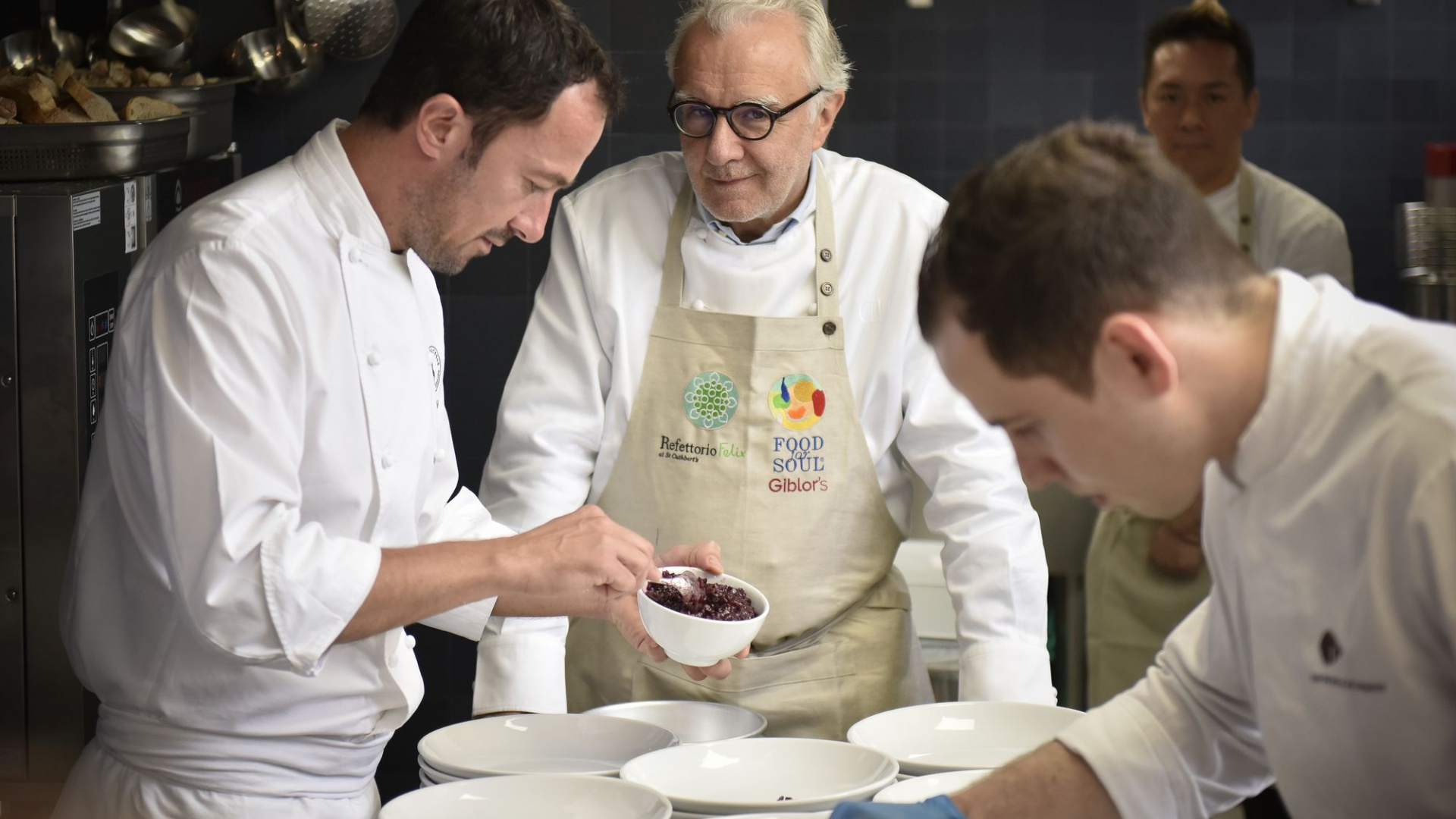 Alain Ducasse cooking at Massimo Bottura's Food for Soul project