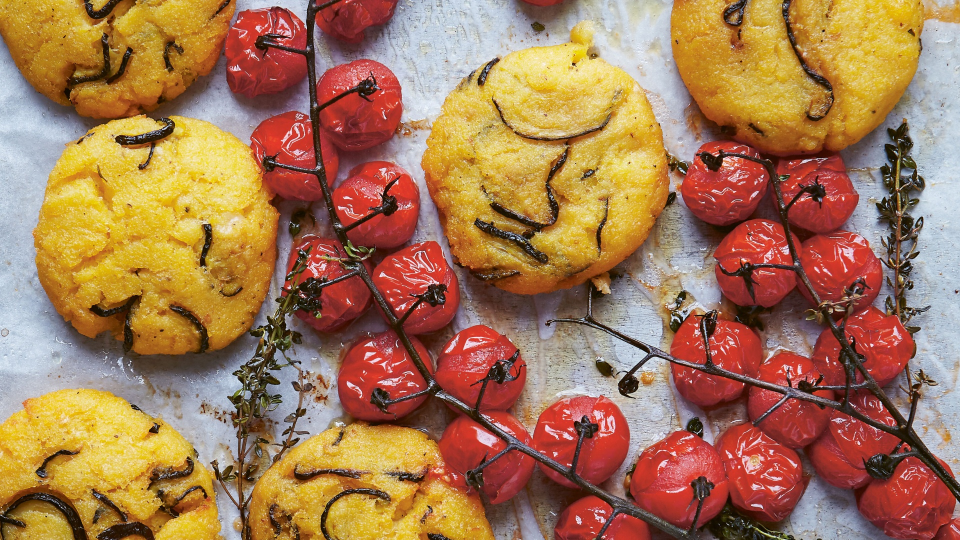 Make Eleanor Maidment's courgette and pecorino polenta cakes with vine-roasted tomatoes and dry-cured ham