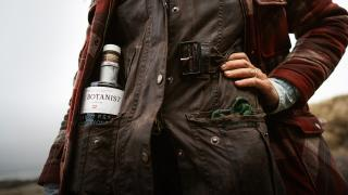 A forager with a bottle of The Botanist Gin