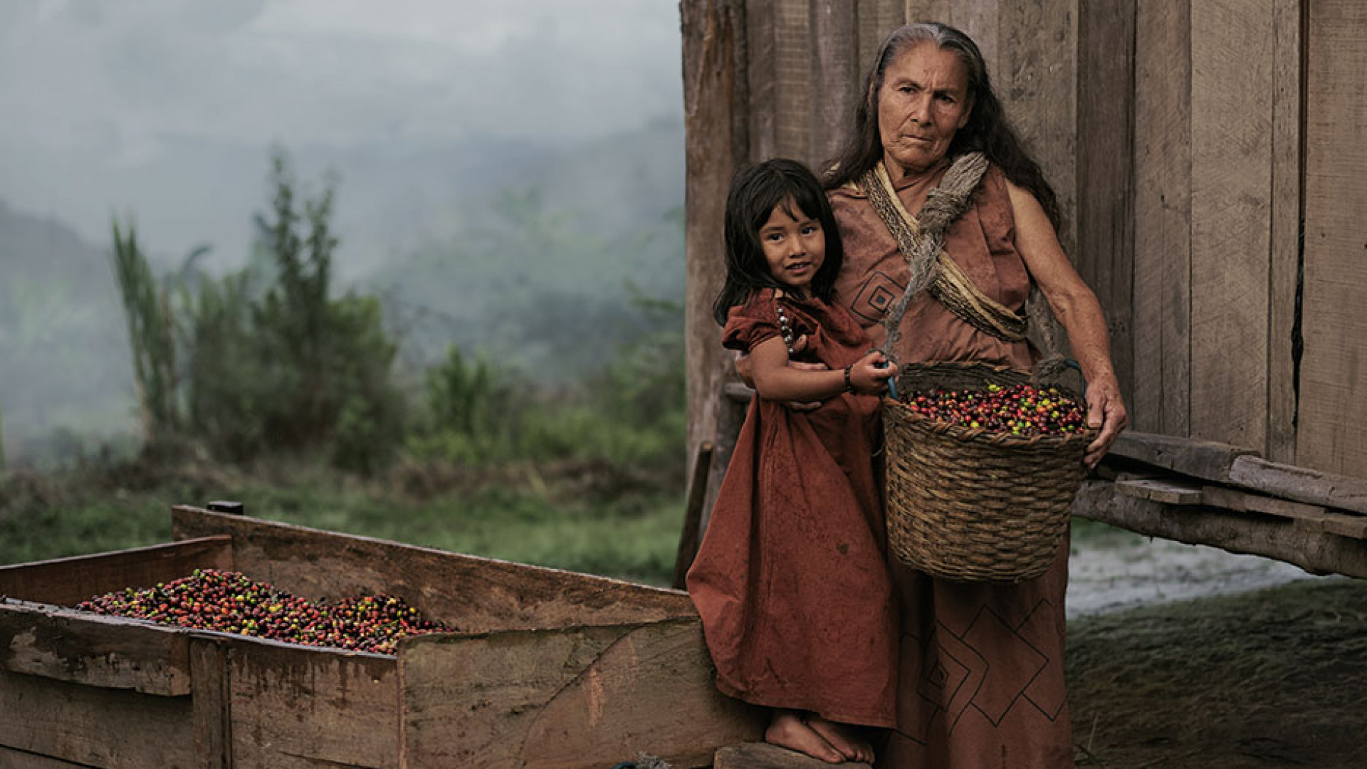 A farmer holds her daughter in Peru