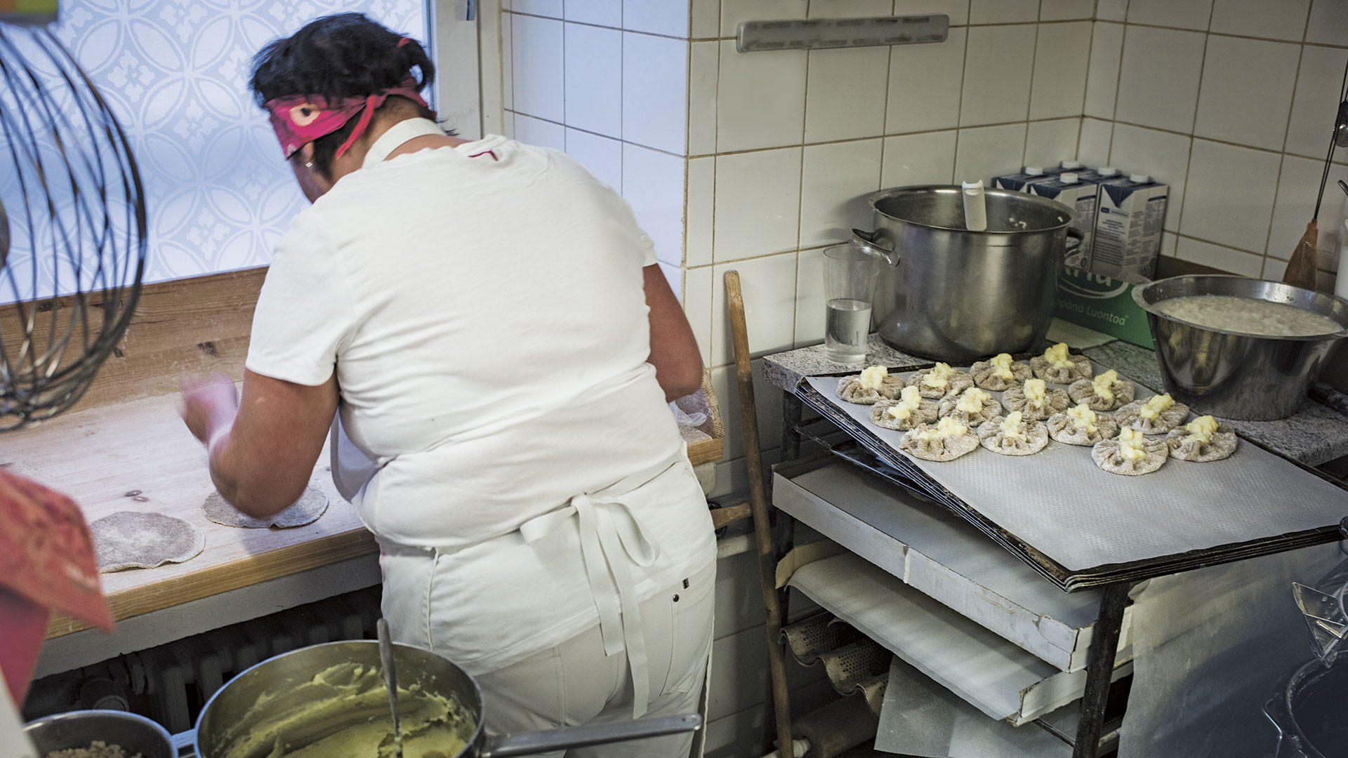 Preparing Karelian pasties in a bakery, Helsinki, Finland, Autumn 2013, from Magnus Nilsson's Nordic: A Photographic Essay of Landscapes, Food and People