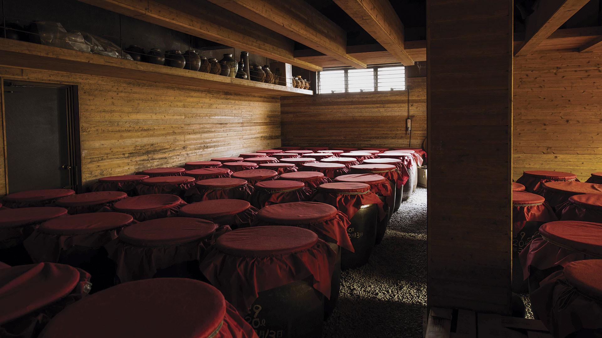 Awamori aging in ceramic urns at Zuisen