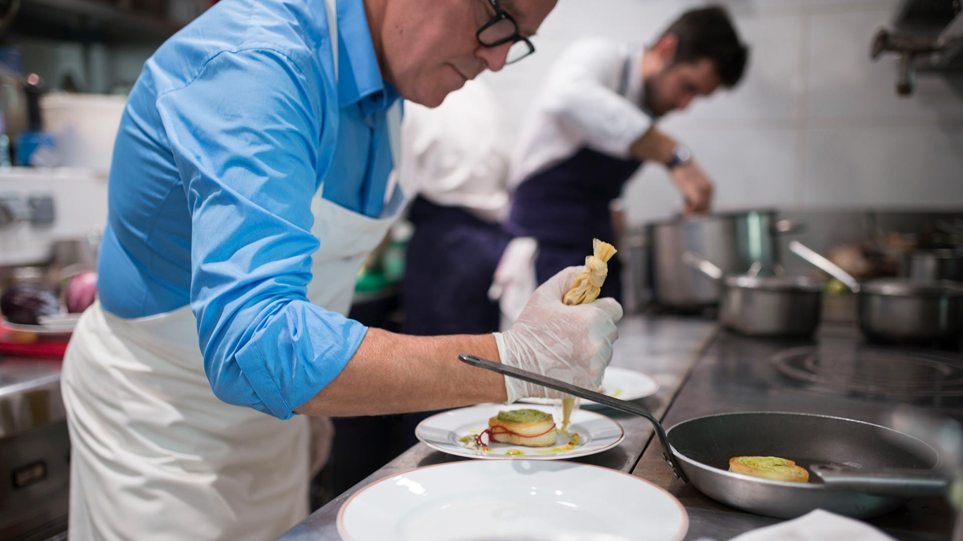 Alain Passard prepares a dish at L'Arpège