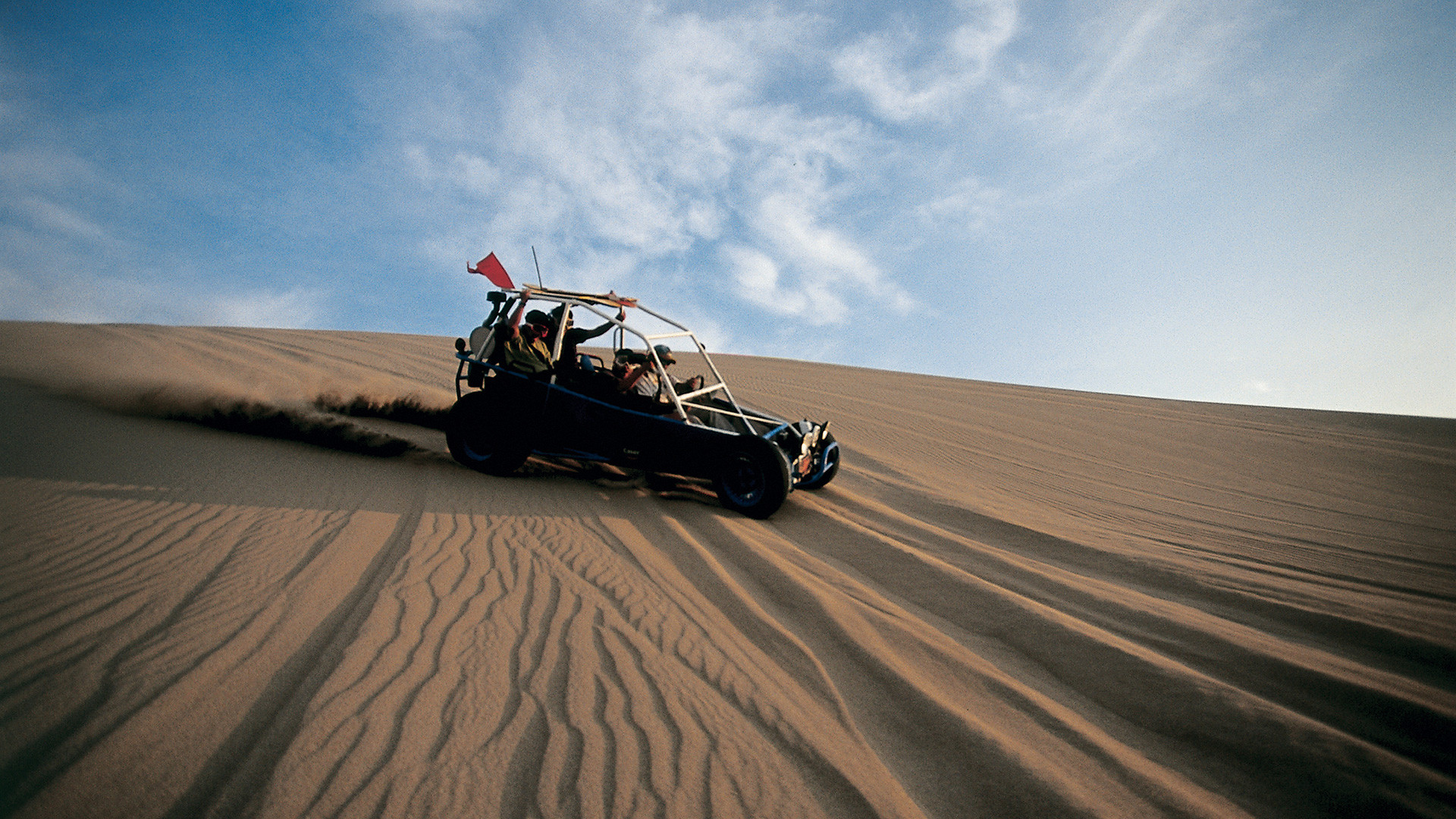 Sandboarding in the dunes around the Huacachina oasis