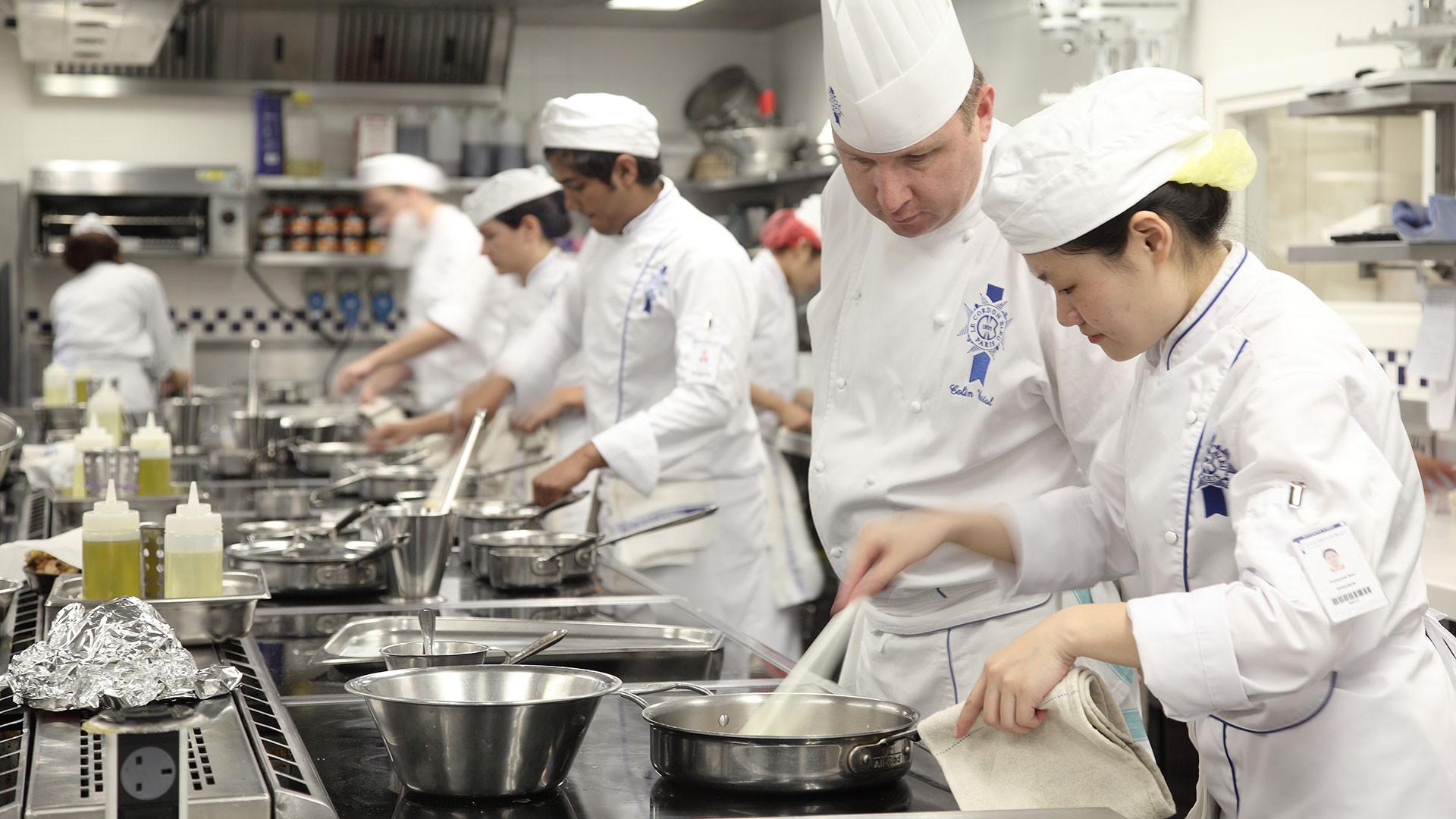 Cooks in Le Cordon Bleu's kitchens
