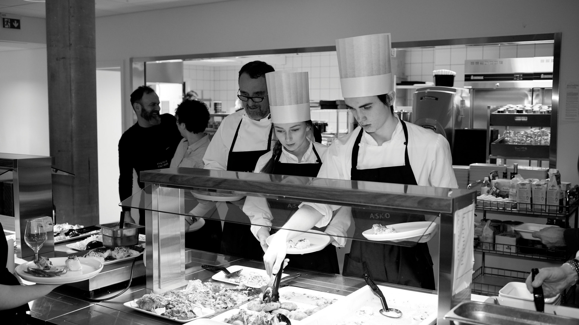 Chefs and students cooking at the Norwegian Seafood Council's offices