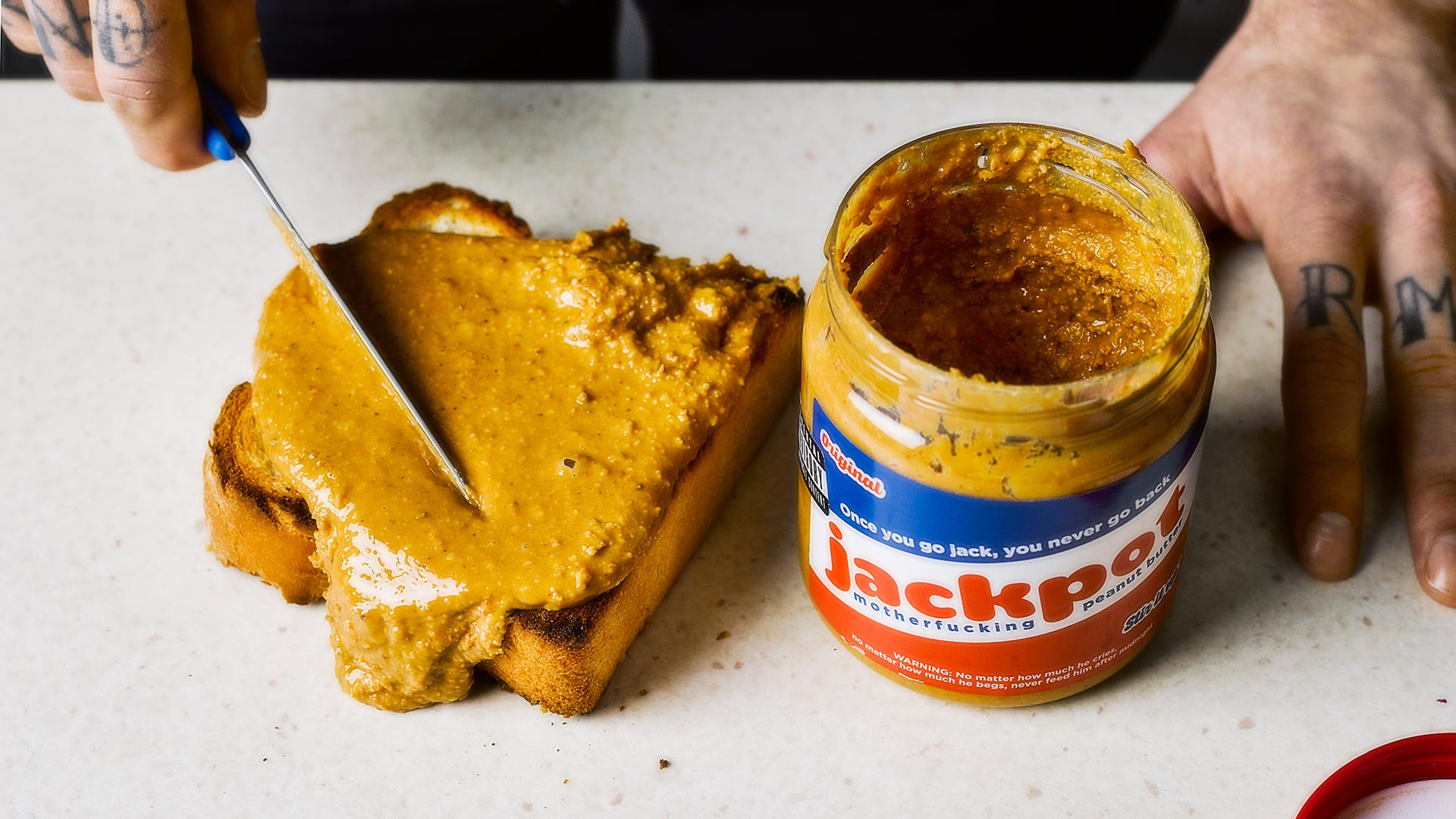 Jackpot Motherfucking Peanut Butter spread over toast