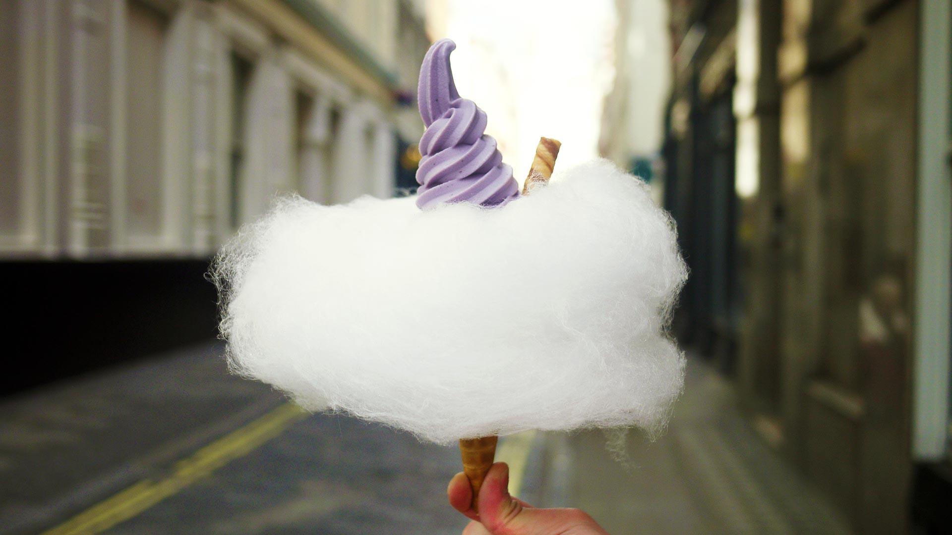Blueberry soft serve and candy floss cone from Milk Train