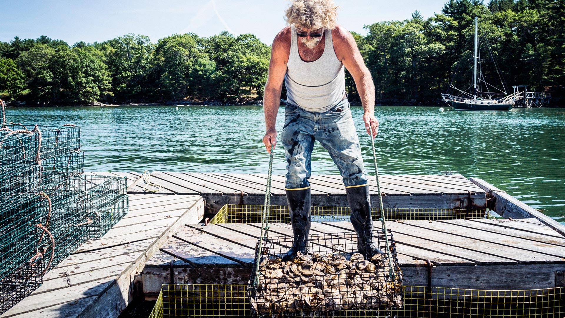 An oyster man harvests his crop in Maine; photograph: National Geographic Creative / Alamy Stock Photo