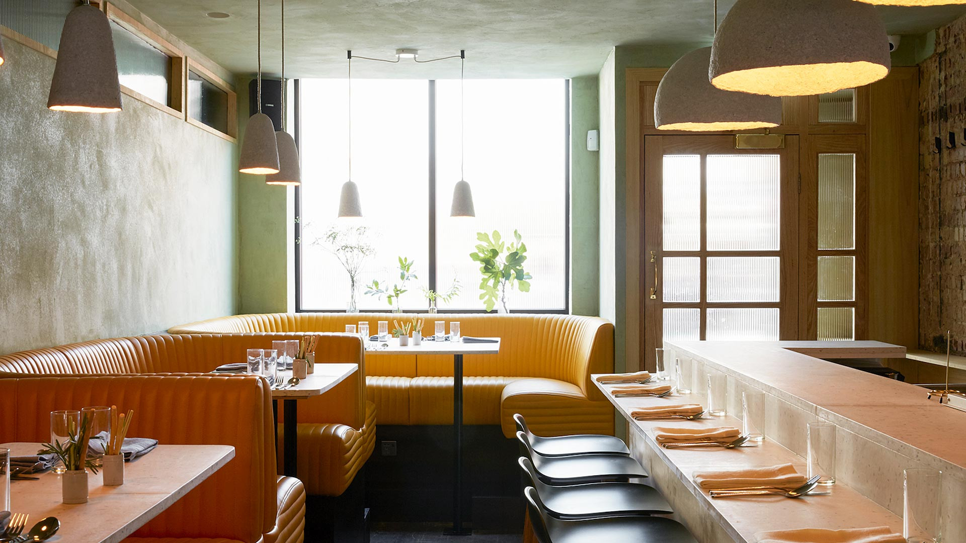 The interior design of Cub combines a vibrant colour scheme with a pared-down aesthetic and classic marble bar