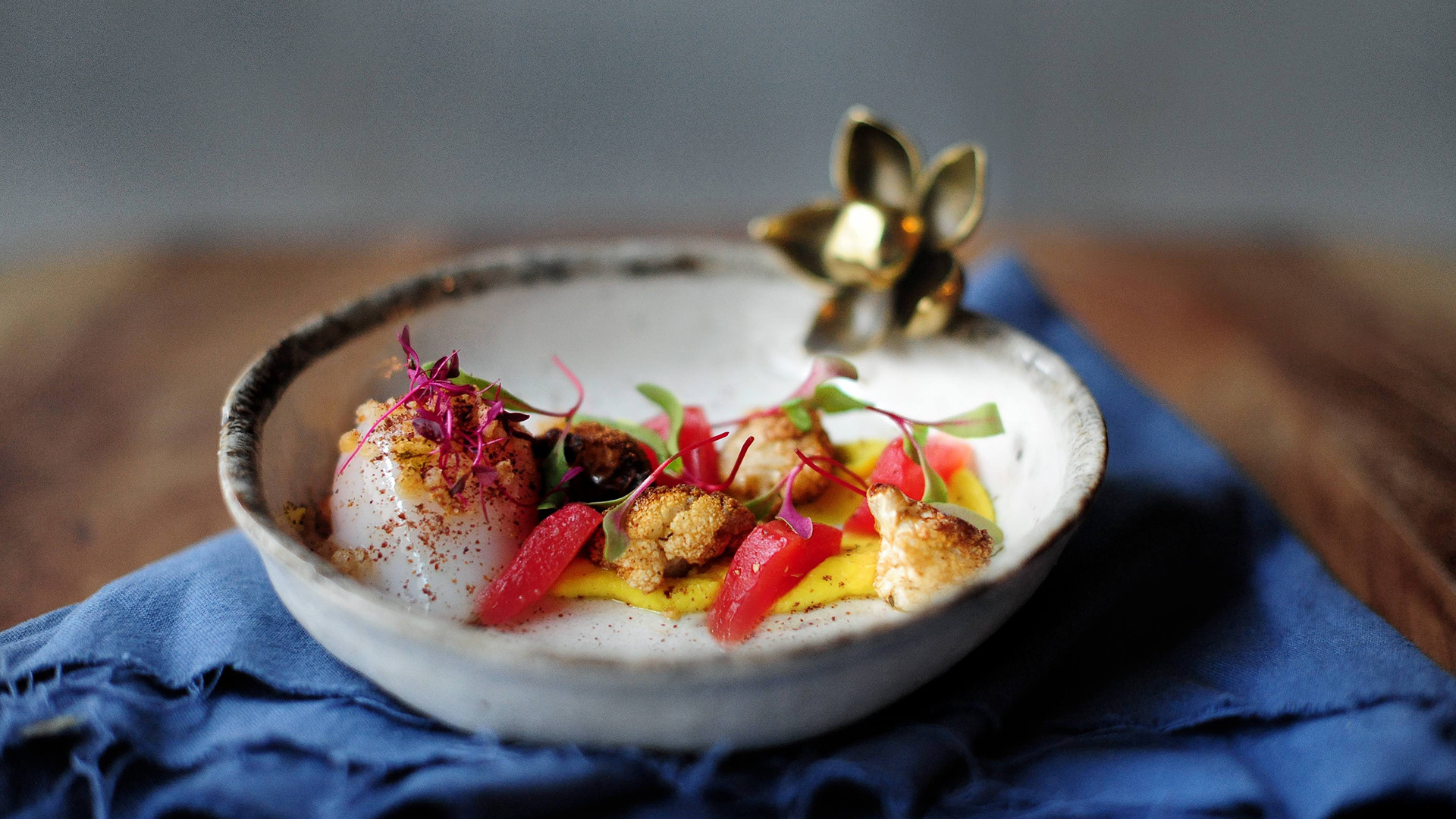 Slow-cooked duck egg with triple cauliflower and pickled watermelon
