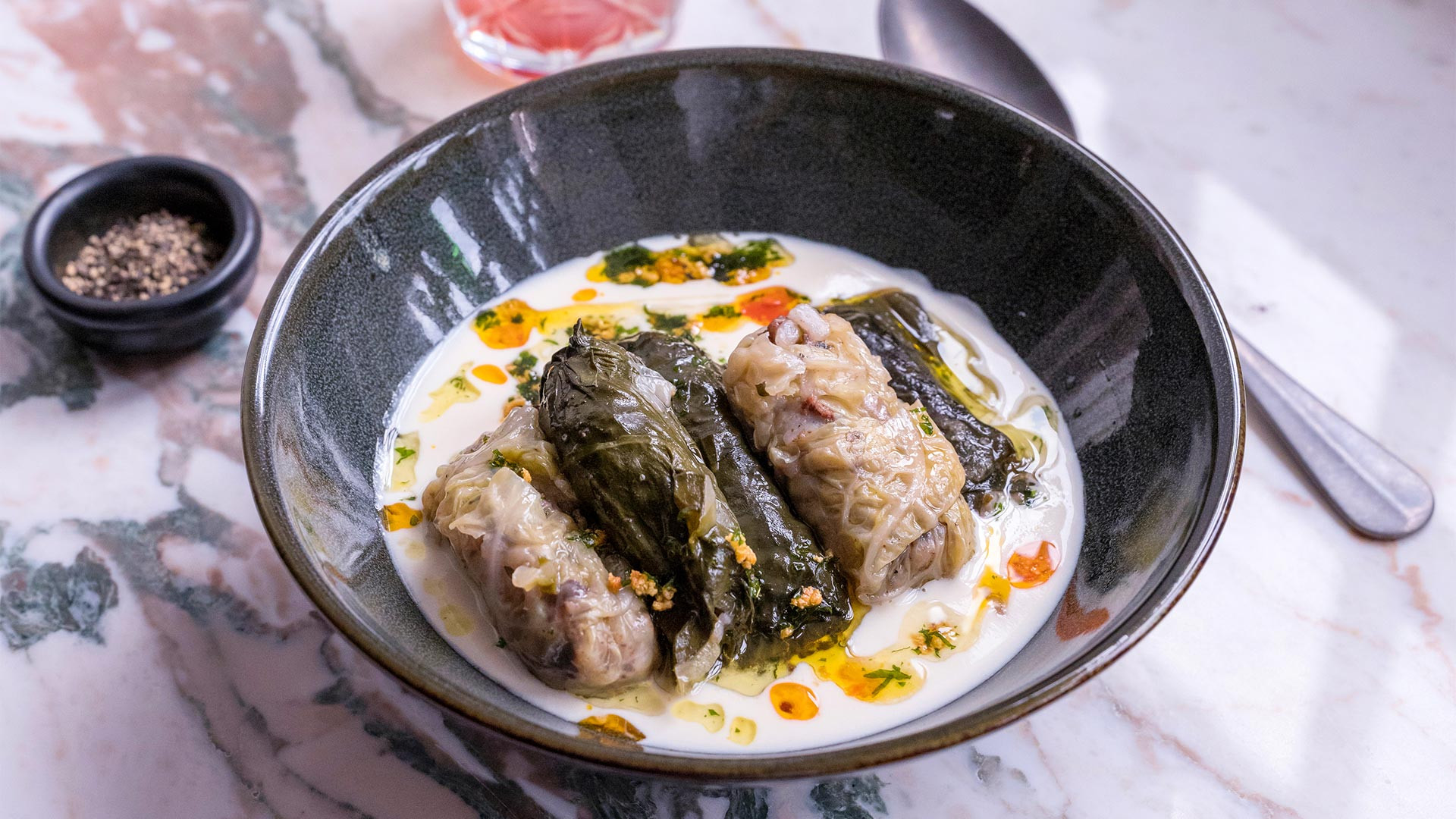 Villa Mama's warak enab, vine leaves filled with rice, tomatoes and herbs