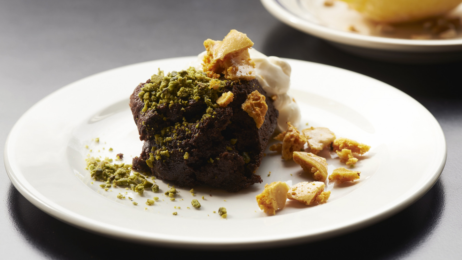 Chocolate cake with honeycomb and crushed pistachios from Rotorino, Dalston