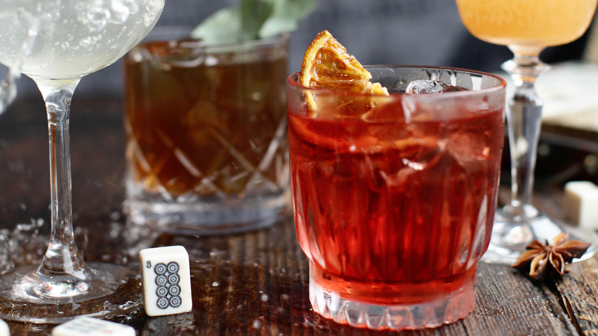 Barrel-aged plum wine negroni made from campari, gin, plum wine and chocolate bitters