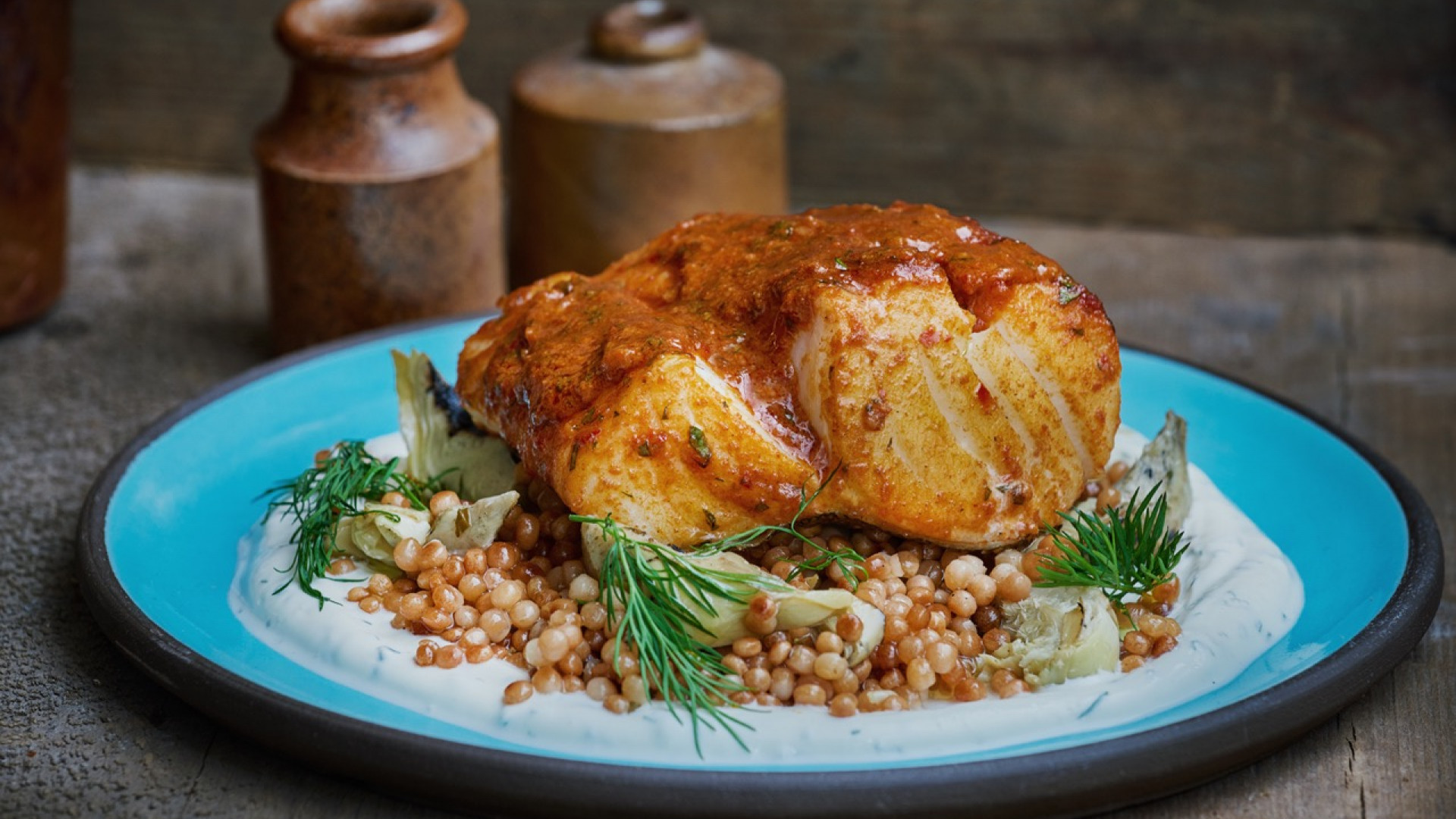 Cod smothered in chermoula with artichokes and Israeli cous cous