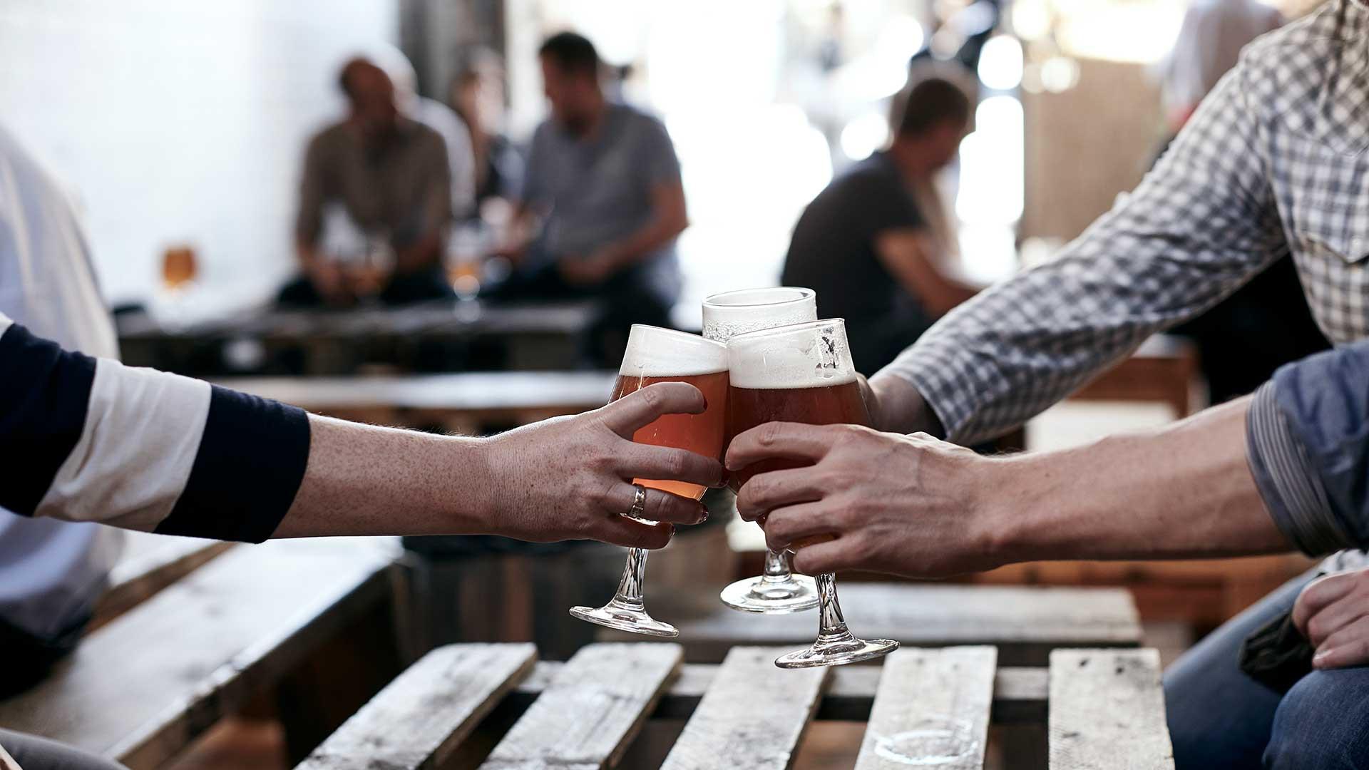 Friends drinking beer in Brick's taproom in Peckham