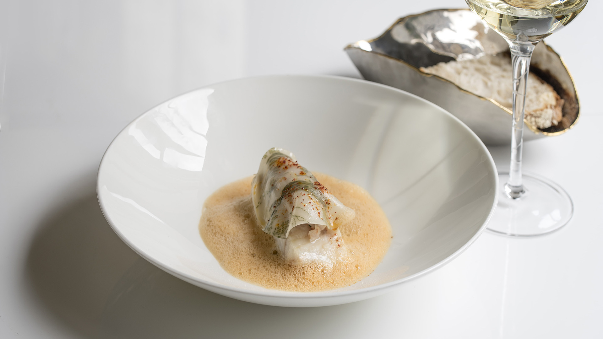 Braised turbot, Chateau Chalon sauce with native-lobster ravioli from Roux at the Landau