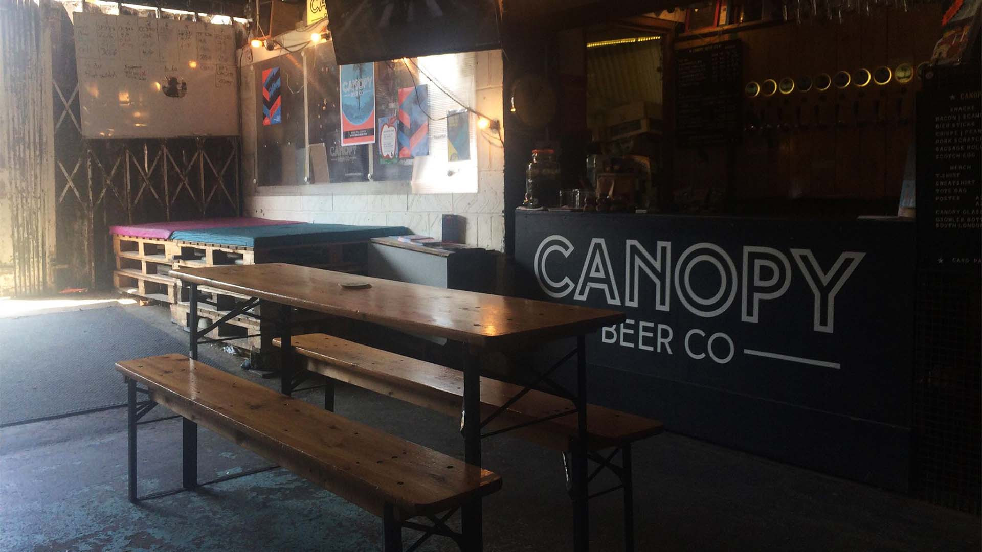 Interior of Canopy Beer Co taproom and brewery in Herne Hill, London
