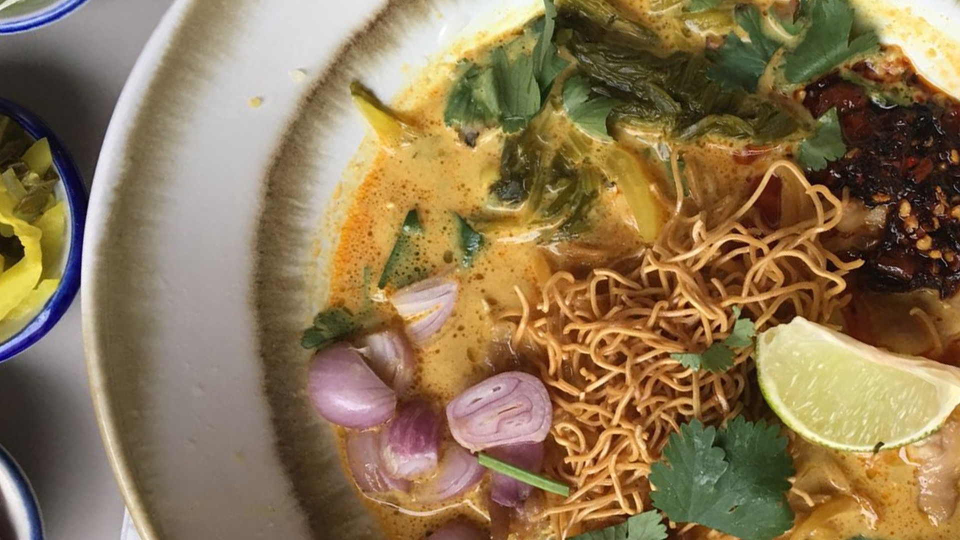 Khao soi gai, a huge, turmeric-yellow curried coconut noodle soup from Chiang Mai