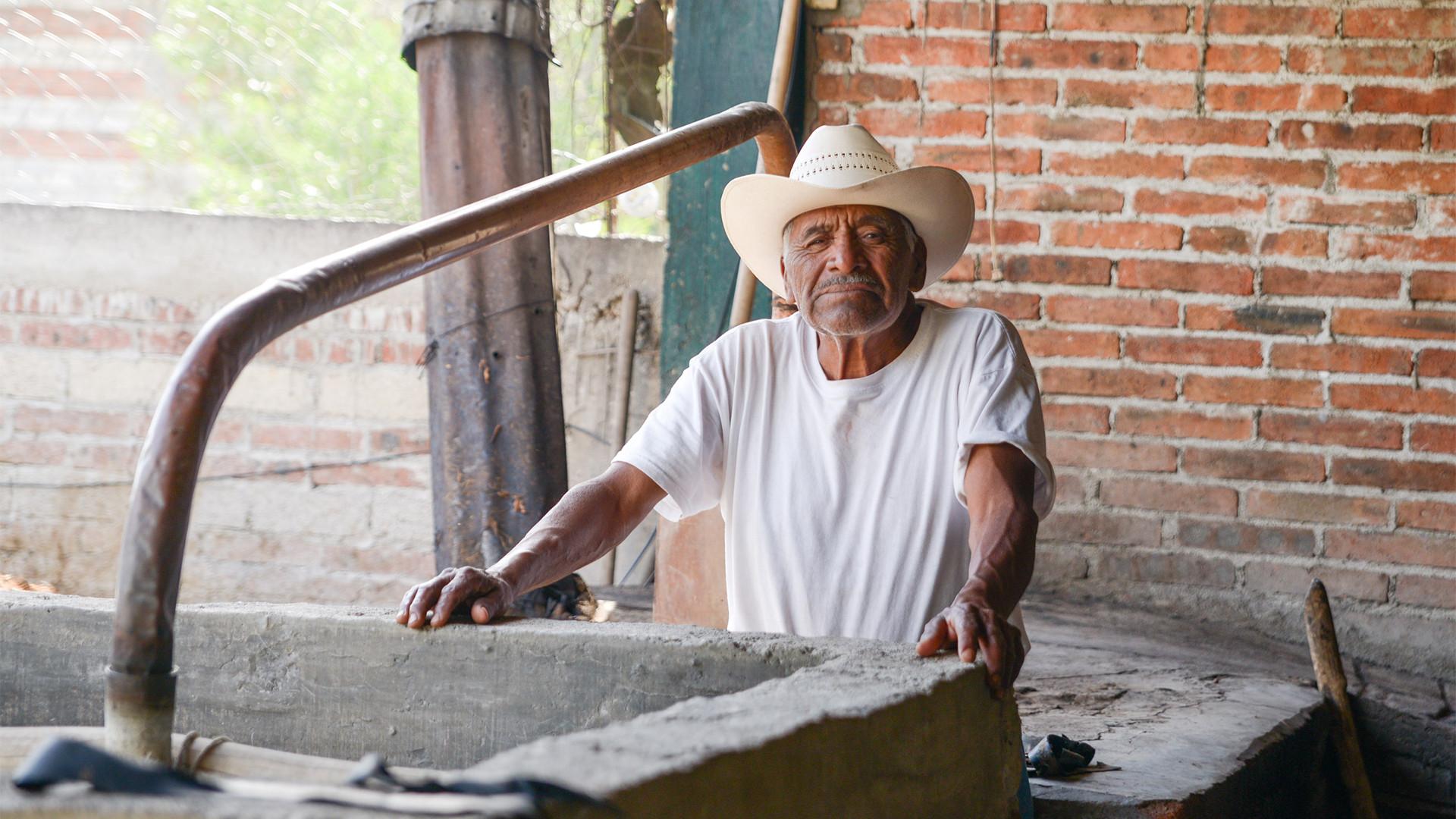 A mezcalero in the a mezcal palenque in Oaxaca