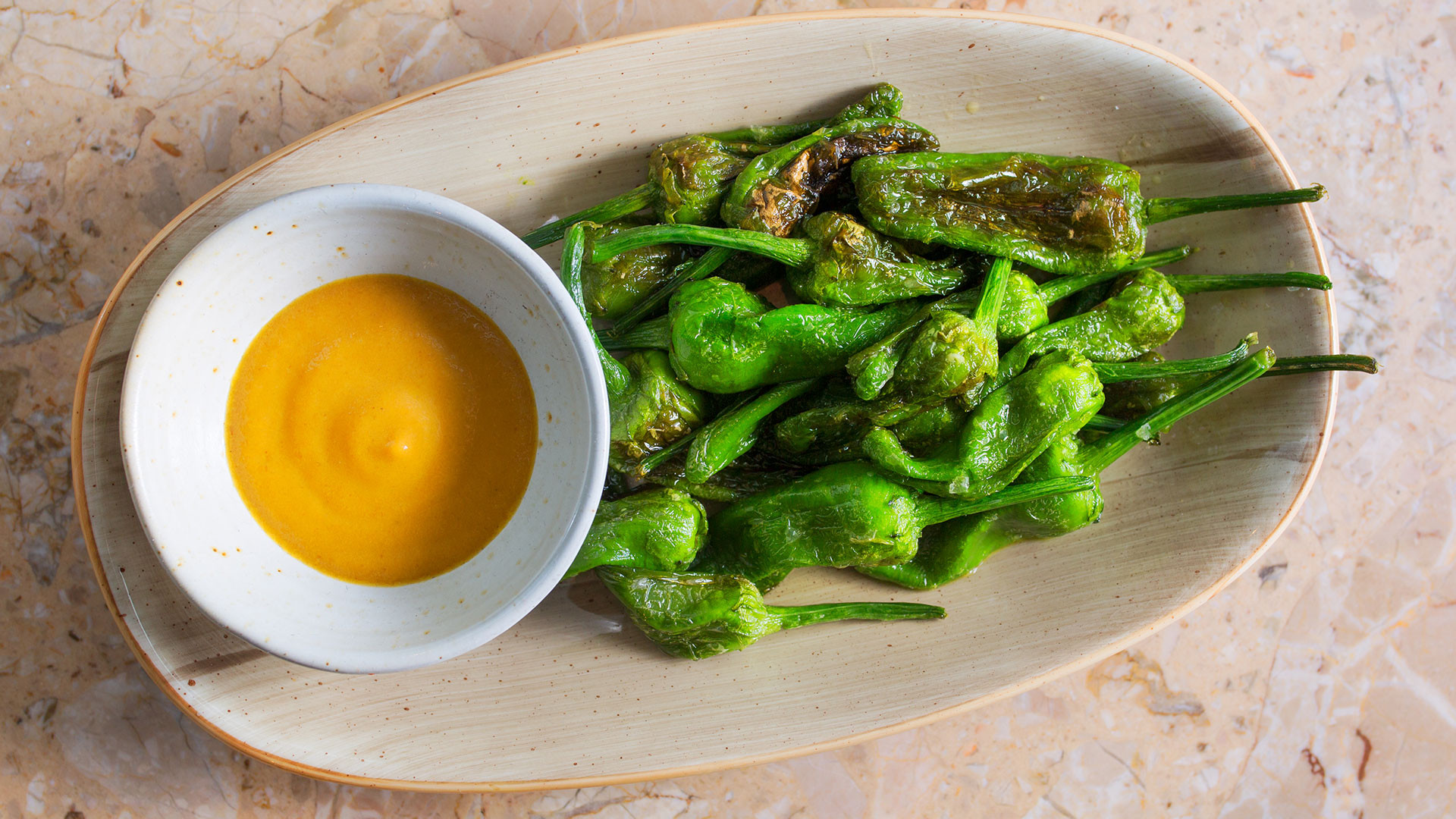 Blistered padrón peppers at Rambla in Soho
