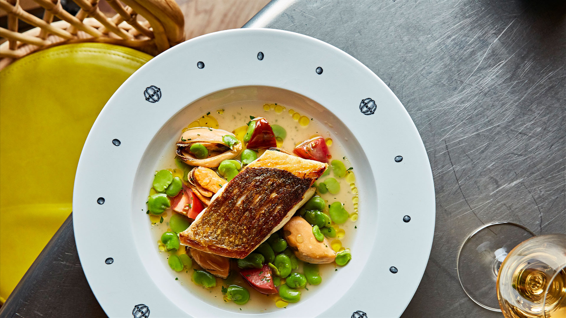 Seabass, Iberico tomatoes, mussel and broad bean broth
