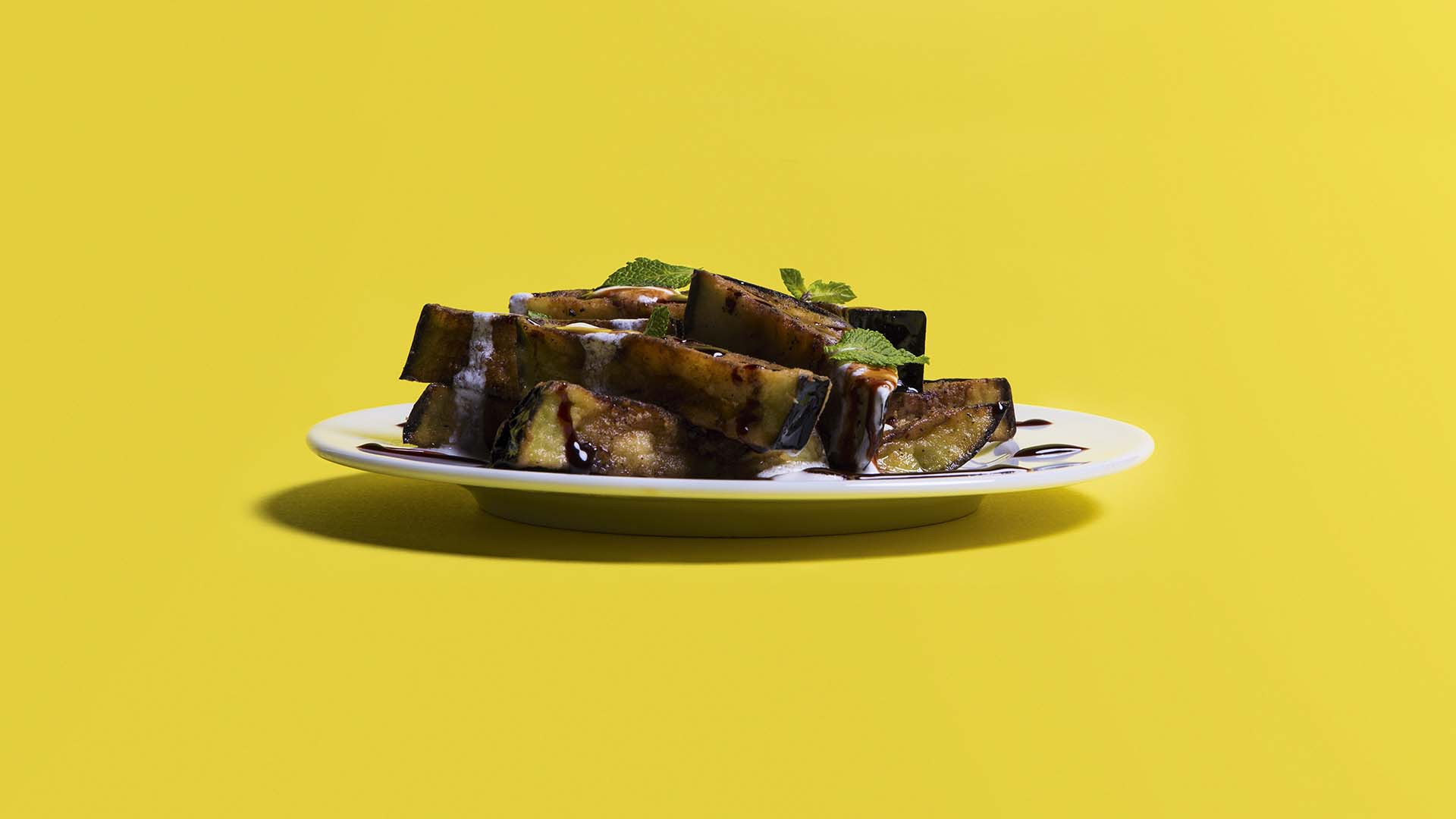 Fried aubergine with date molasses and feta