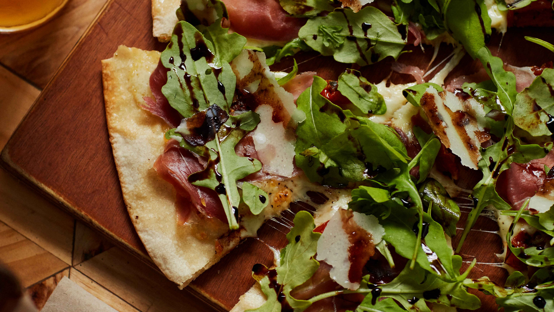 Crate's prosciutto and rocket pizza