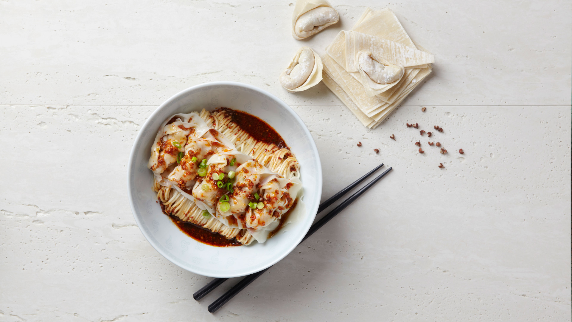 Pork and prawn wontons with noodles in Sichuan sauce
