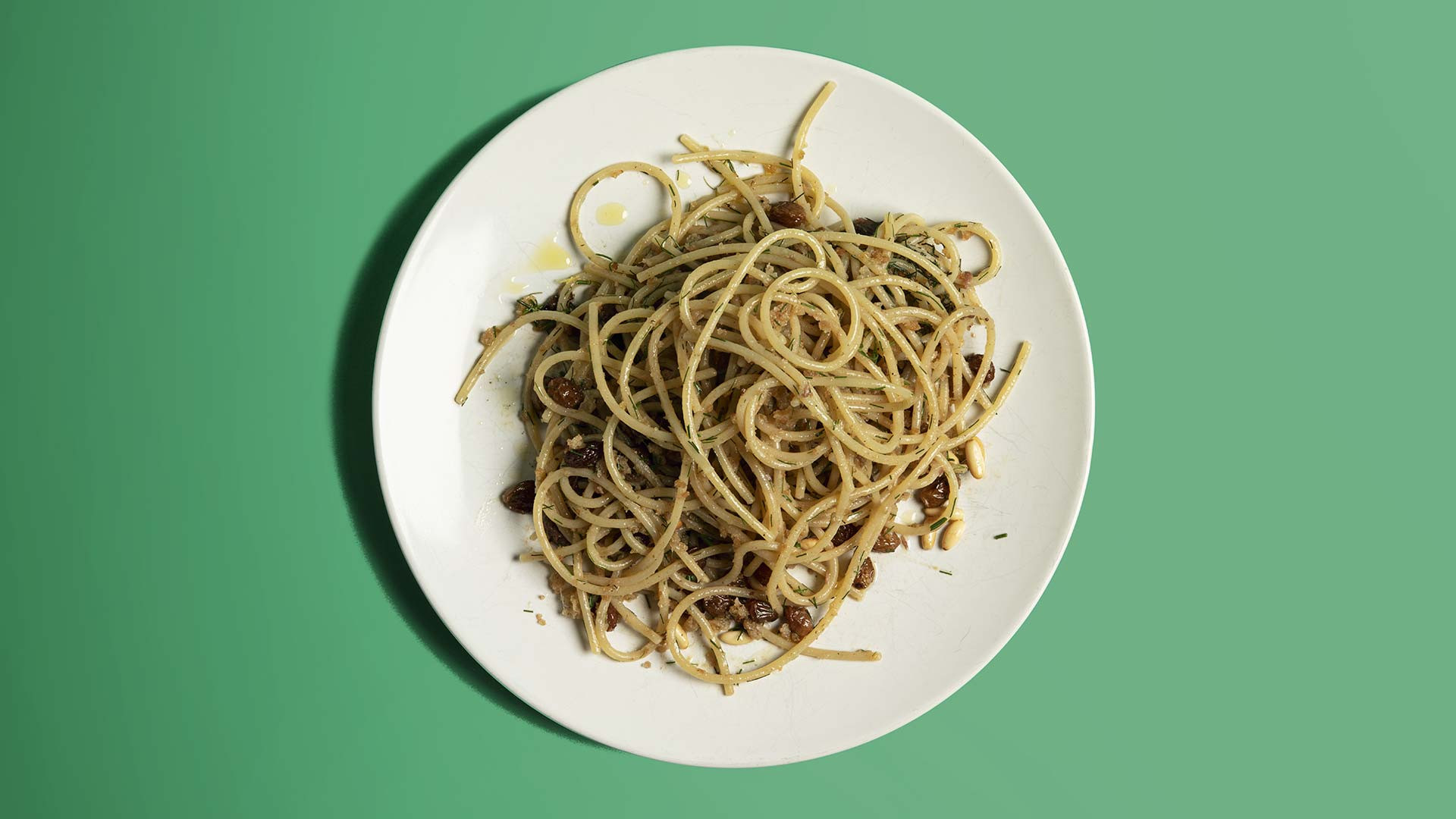 Spaghetti with anchovy, pine nuts, sultanas and wild fennel