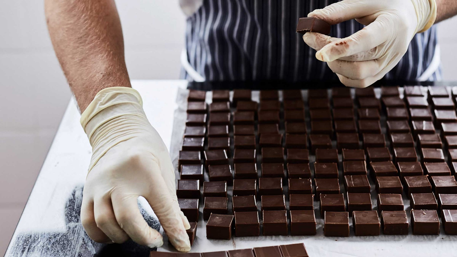 One of the Rococo team making fresh chocolates