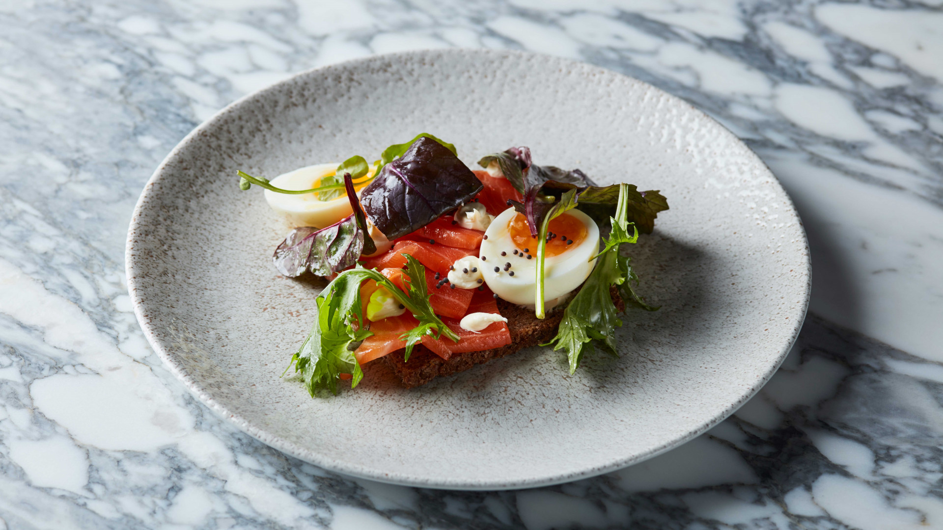 Cured salmon, soured cream, soft-boiled egg and rye at Lino, Clerkenwell