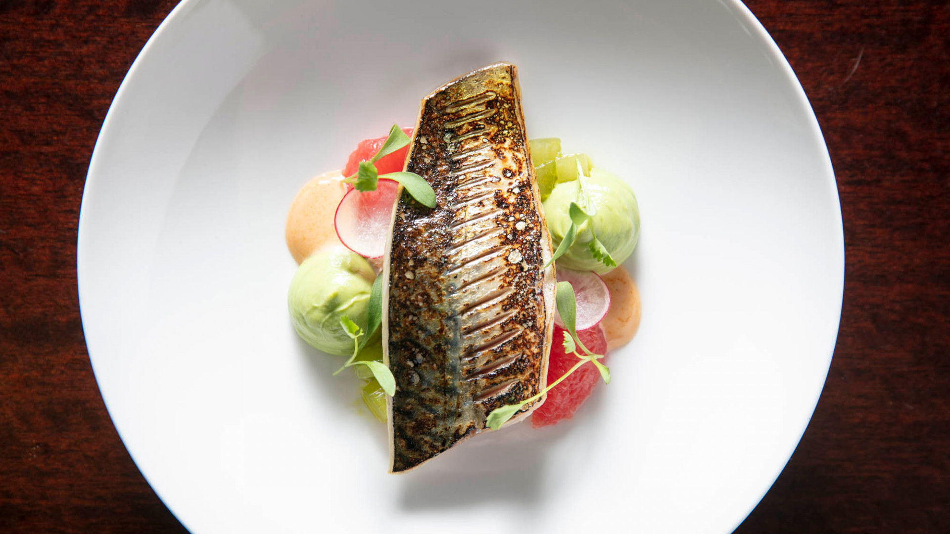Barbecued Cornish mackerel, dressed crab, brown crab emulsion, avocado purée, pickled mooli and pink grapefruit