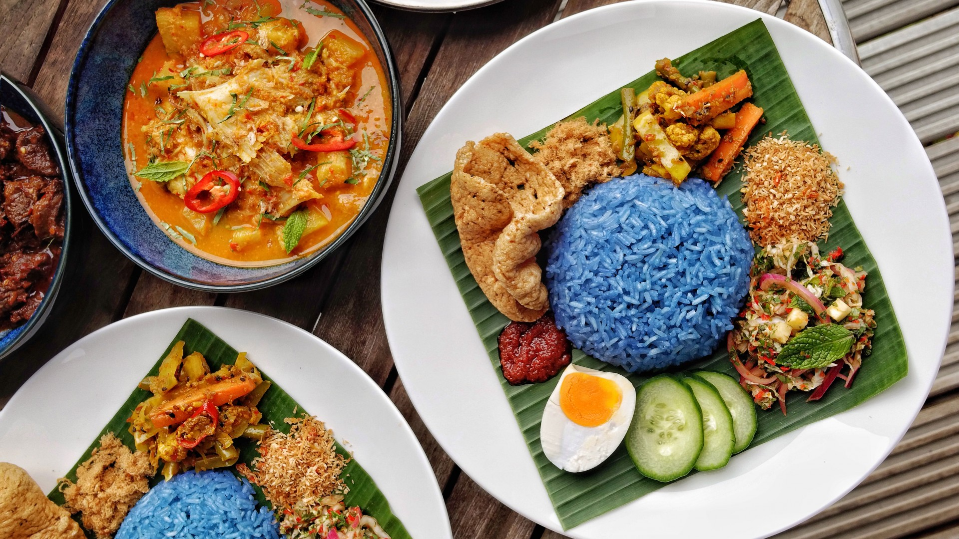 Blue pea flower and herb rice (Nasi-Kerabu) with skate curry