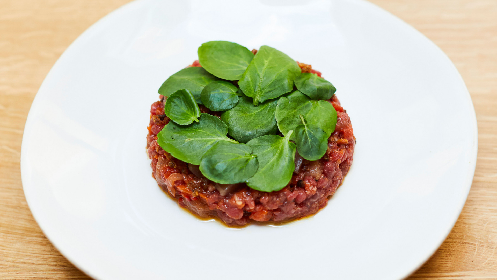 Beef and tuna tartare with winter tomatoes