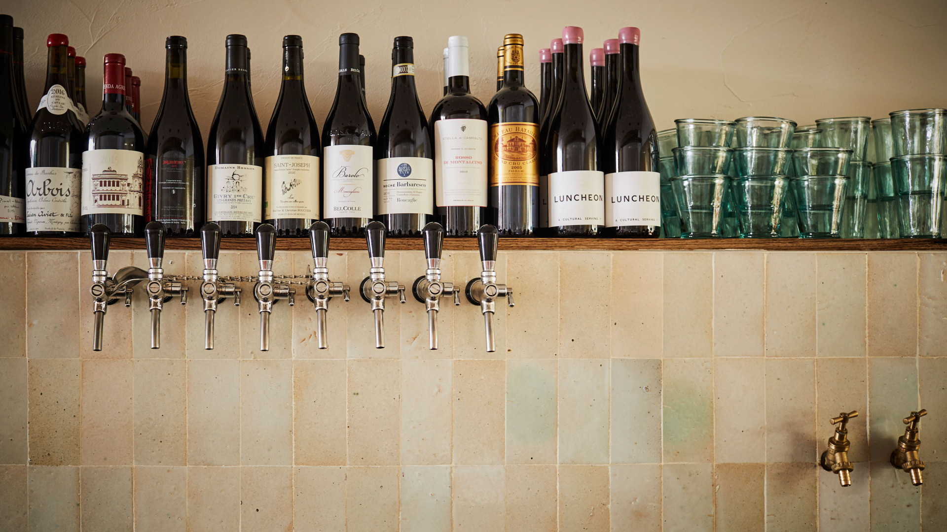 Wine bottles and wine taps at Orasay, Notting Hill