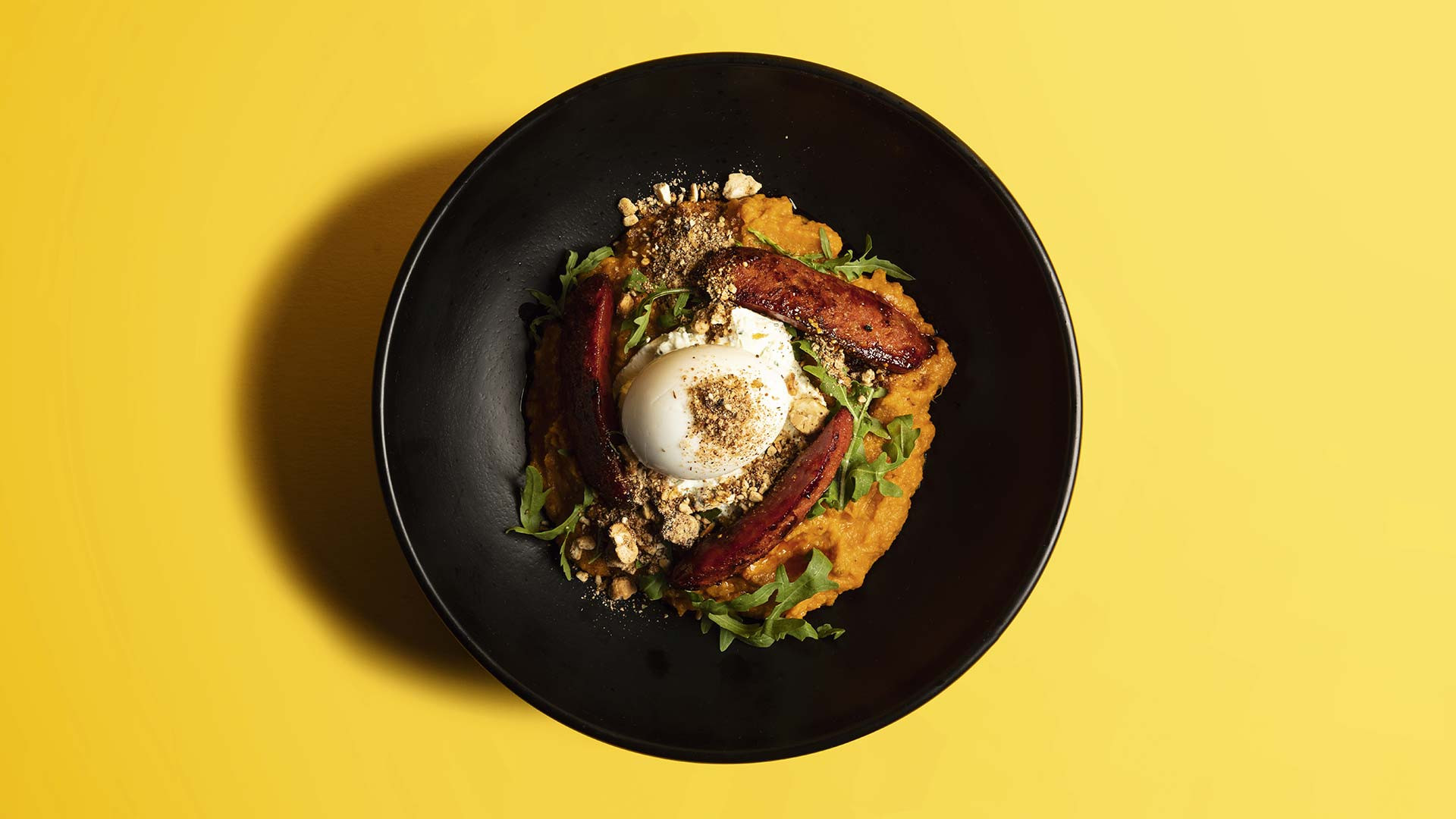Sweet potato miso hash with chorizo, cashew praline and a boiled egg