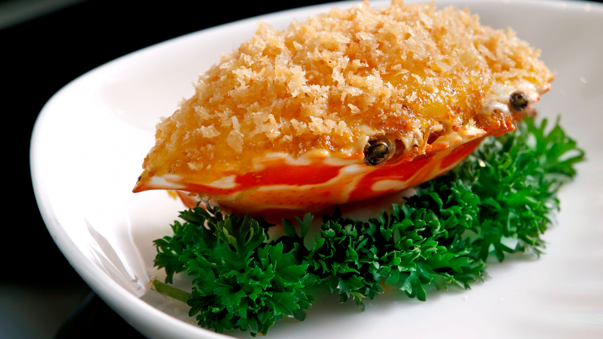 Baked crab meat, cheese and onions on crab shell