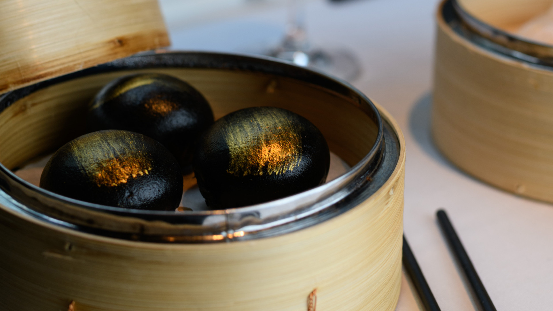 Steamed charcoal buns with custard