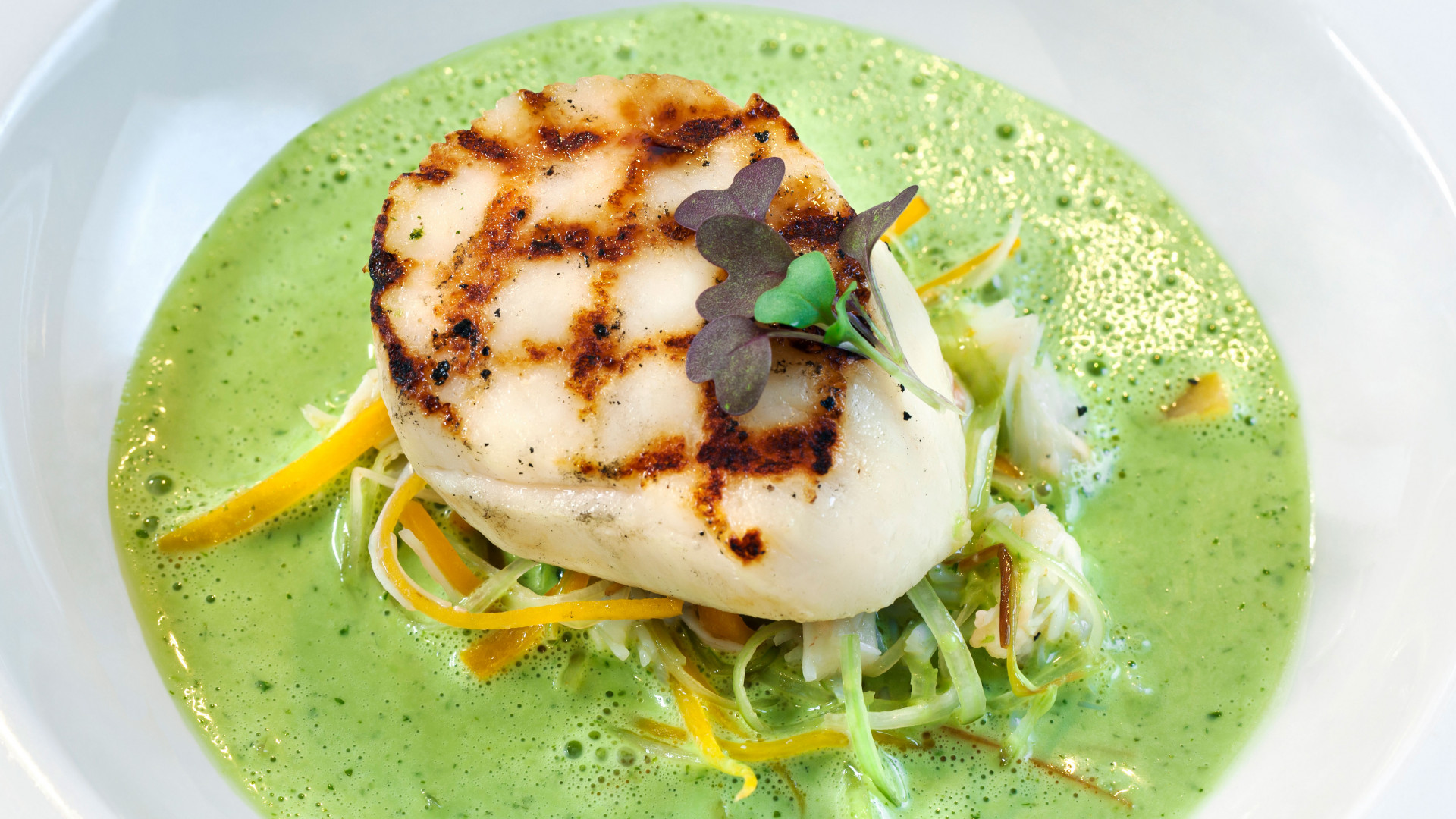 Grilled scallops with crab and herb velout